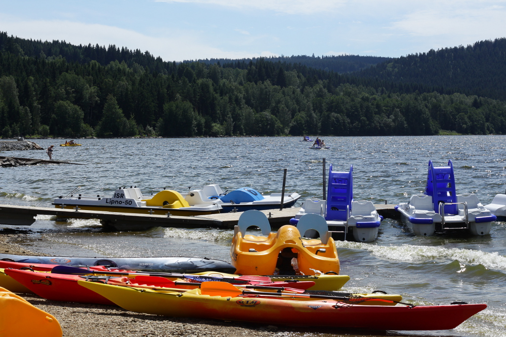 Canoeing around Frymburk, Lipno lake, Bohemia. Seakayaks and recreational boats.